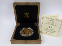 A Royal Mint 1997 £5.00 Gold Coin £900.jpg