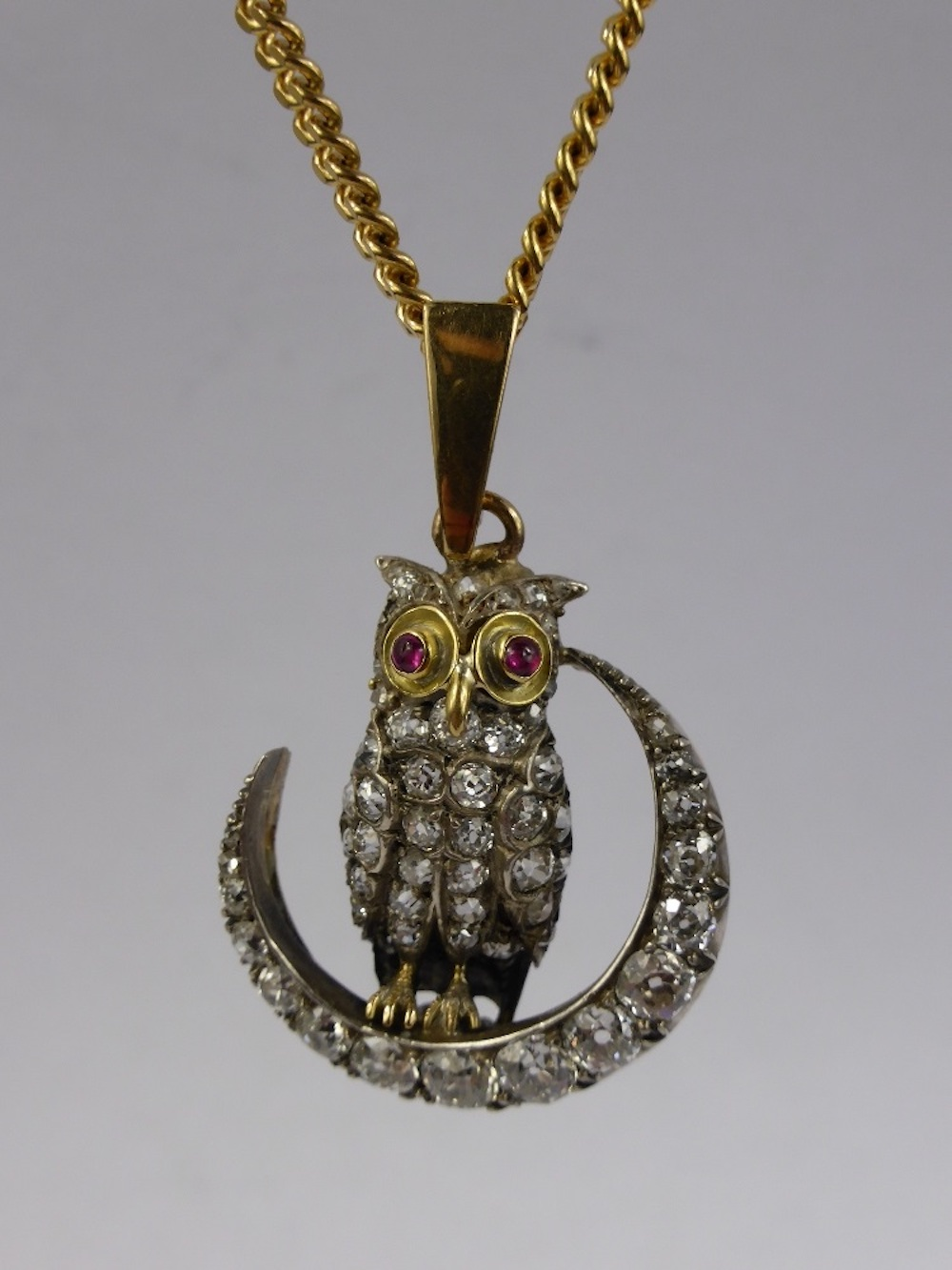 An 18ct Gold, Diamond & Ruby Owl Pendant £1000.jpg
