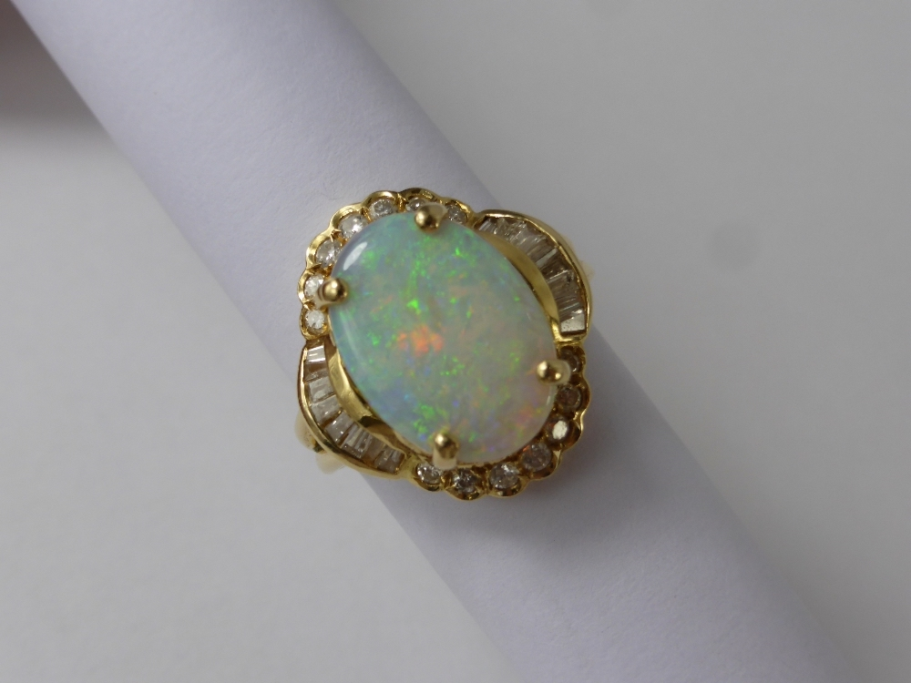 Lady's 14 K Diamond and Opal Ring £370