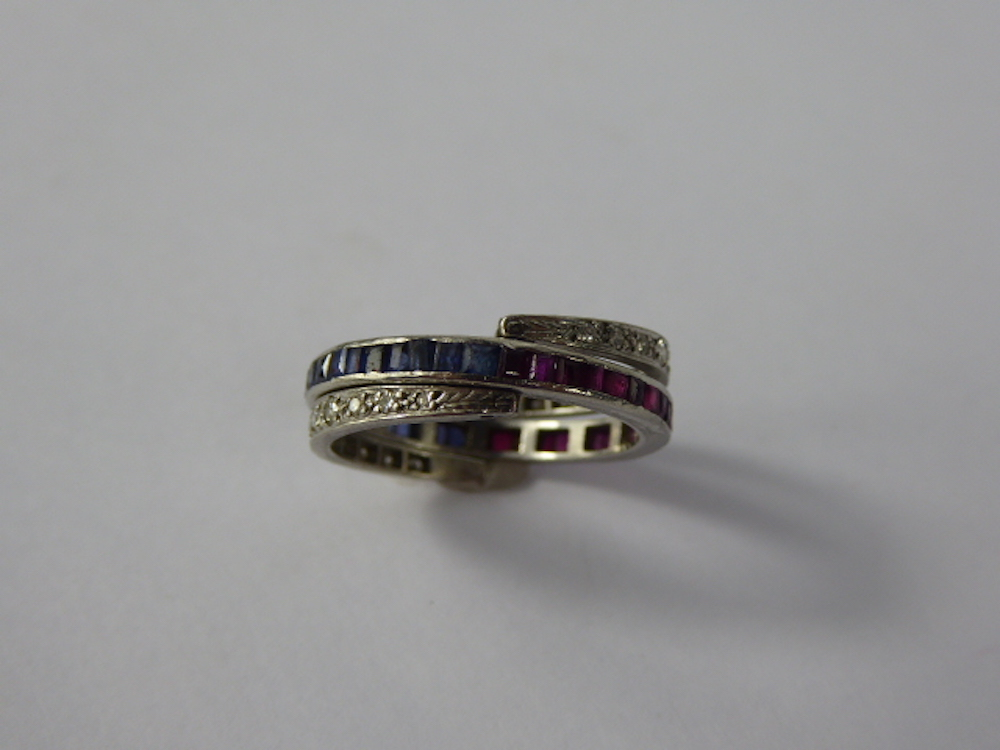 A Platinum Diamond, Ruby and Sapphire Ring £340