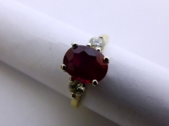 18 ct Yellow Gold Three Stone Ruby Ring £700