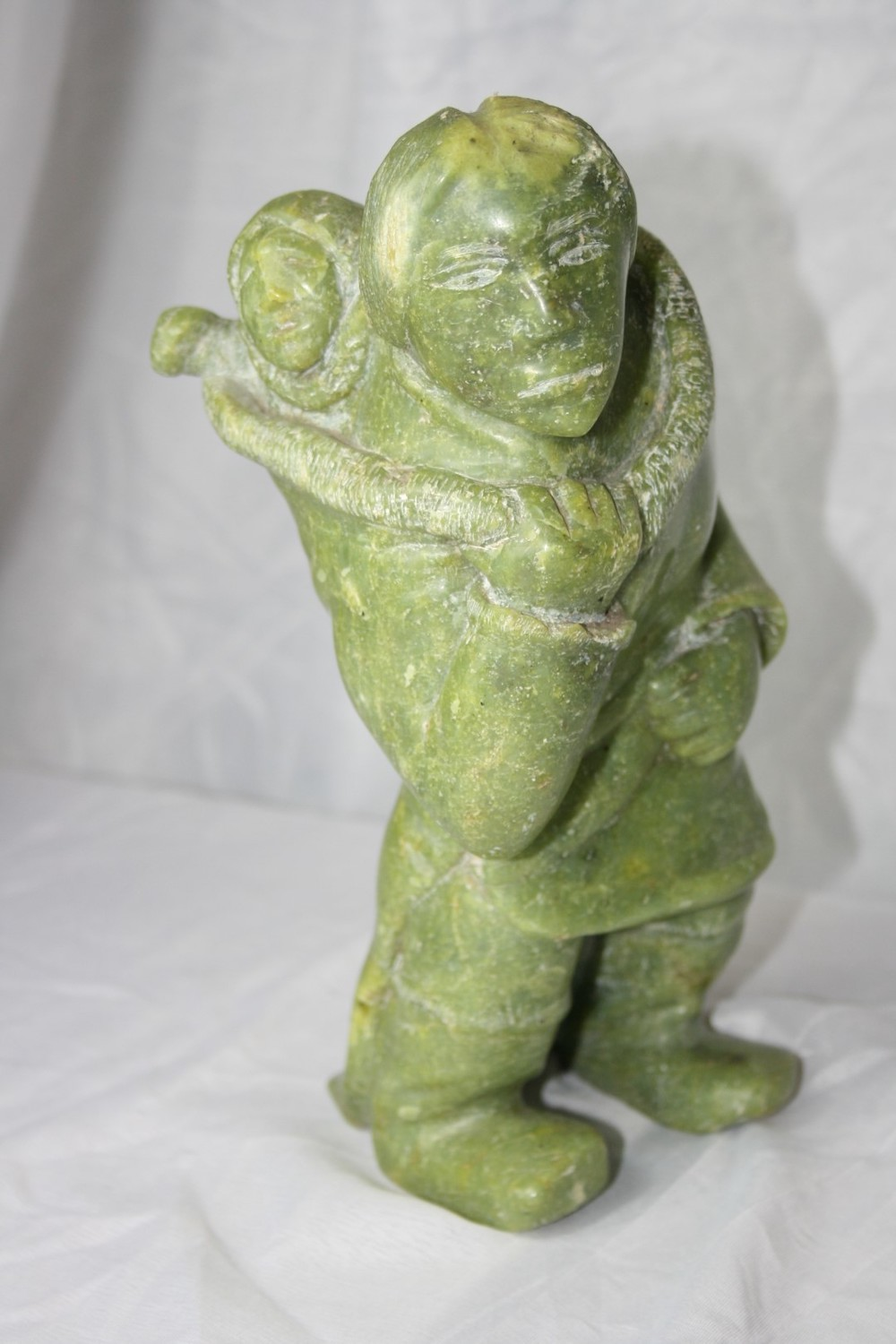 Carved Green Stone figure of an Eskimo £320